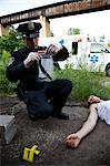 Police Officer with Evidence and Corpse on Crime Scene, Toronto, Ontario, Canada