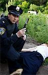 Police Officer with Corpse and Bloody Knife, Toronto, Ontario, Canada