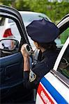 Police Woman in Cruiser at Side of Road, Toronto, Ontario, Canada    Stock Photo - Premium Rights-Managed, Artist: Blue Images Online, Code: 700-02348273