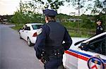 Police with Car at Side of Road, Toronto, Ontario, Canada Stock Photo - Premium Rights-Managed, Artist: Blue Images Online, Code: 700-02348274