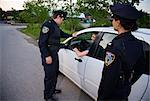 Police with Car at Side of Road, Toronto, Ontario, Canada    Stock Photo - Premium Rights-Managed, Artist: Blue Images Online, Code: 700-02348275