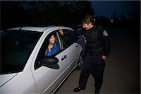 female police officer happy - Police Officer Pulling Woman Over, Toronto, Ontario, Canada    Stock Photo - Premium Rights-Managednull, Code: 700-02348277