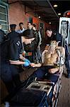 Paramedic with Injured Man by Ambulance, Toronto, Ontario, Canada    Stock Photo - Premium Rights-Managed, Artist: Blue Images Online, Code: 700-02348281