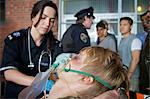 Paramedic with Injured Man by Ambulance, Toronto, Ontario, Canada    Stock Photo - Premium Rights-Managed, Artist: Blue Images Online, Code: 700-02348283