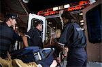 Paramedics and Police loading Injured man into Ambulance, Toronto, Ontario, Canada    Stock Photo - Premium Rights-Managed, Artist: Blue Images Online, Code: 700-02348285