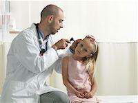 Doctor examining girl Stock Photo - Premium Royalty-Freenull, Code: 649-02348489