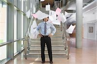 Businessman Throwing Papers Up in the Air Stock Photo - Premium Rights-Managednull, Code: 700-02348554