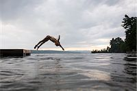 Girl Diving off Floating Dock, Naples, Maine, USA    Stock Photo - Premium Rights-Managednull, Code: 700-02348589