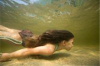Girl Swimming Underwater    Stock Photo - Premium Rights-Managednull, Code: 700-02348591