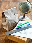 School Supplies, Lunch Bag and Globe on Desk    Stock Photo - Premium Royalty-Free, Artist: Michael Alberstat, Code: 600-02348718