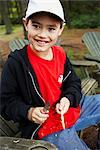 Boy Carving a Stick With His First Pocket Knife, Algonquin Park, Ontario, Canada    Stock Photo - Premium Royalty-Free, Artist: Dan Lim, Code: 600-02348735