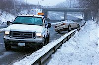 Tow Truck and Car Stuck on Guard Rail on Icy Highway, Toronto, Ontario, Canada    Stock Photo - Premium Rights-Managednull, Code: 700-02348737