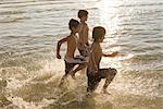 Boys Running in the Water    Stock Photo - Premium Rights-Managed, Artist: Pierre Arsenault, Code: 700-02348772