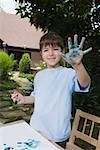 Boy painting with paint on hand Stock Photo - Premium Royalty-Free, Artist: Paul Eekhoff, Code: 604-02370774