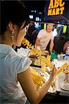 Woman at Food Stall, Myeong-dong Shopping Area, Seoul, South Korea    Stock Photo - Premium Rights-Managed, Artist: R. Ian Lloyd, Code: 700-02370968
