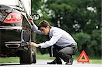 Man inspecting car Stock Photo - Premium Royalty-Free, Artist: AlaskaStock, Code: 656-02371874