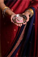 singapore traditional costume lady - Indian woman offering sweets Stock Photo - Premium Royalty-Freenull, Code: 655-02375849