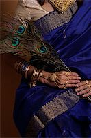 singapore traditional costume lady - Torso of Indian woman holding peacock feathers Stock Photo - Premium Royalty-Freenull, Code: 655-02375866