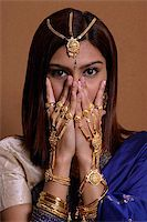 singapore traditional costume lady - Indian woman wearing traditional wedding jewelry Stock Photo - Premium Royalty-Freenull, Code: 655-02375876