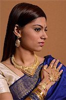singapore traditional costume lady - Indian woman wearing traditional wedding jewelry Stock Photo - Premium Royalty-Freenull, Code: 655-02375882