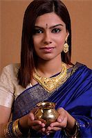 singapore traditional costume lady - Indian woman holding offering Stock Photo - Premium Royalty-Freenull, Code: 655-02375885