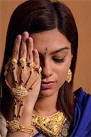 singapore traditional costume lady - Indian woman wearing traditional wedding jewelry Stock Photo - Premium Royalty-Freenull, Code: 655-02375892