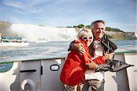 Couple in Boat by Niagara Falls, Niagara Falls, Ontario, Canada    Stock Photo - Premium Rights-Managednull, Code: 700-02376803
