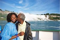 Couple in Boat by Niagara Falls, Niagara Falls, Ontario, Canada    Stock Photo - Premium Rights-Managednull, Code: 700-02376805