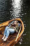 Woman Reading in Rowboat    Stock Photo - Premium Rights-Managed, Artist: Sarah Murray, Code: 700-02376982