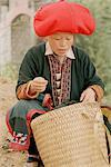 Woman Looking in Basket, Sa Pa, Lao Cai, Vietnam    Stock Photo - Premium Rights-Managed, Artist: Sarah Murray, Code: 700-02377017