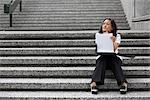 Businesswoman On City Steps    Stock Photo - Premium Rights-Managed, Artist: Sarah Murray, Code: 700-02377039