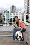 Woman Eating Mango Gelato, Hanging Out With Her French Bulldog, Granville Island, Vancouver, BC, Canada    Stock Photo - Premium Rights-Managed, Artist: Sarah Murray, Code: 700-02377047
