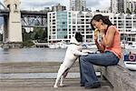 Woman Eating Mango Gelato, Hanging Out With Her French Bulldog, Granville Island, Vancouver, BC, Canada    Stock Photo - Premium Rights-Managed, Artist: Sarah Murray, Code: 700-02377049