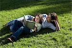 Mother and Daughter Reading on Grass, Buenos Aires, Argentina    Stock Photo - Premium Rights-Managed, Artist: Sarah Murray, Code: 700-02377060