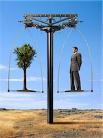 Businessman and Tree on Balance Scale    Stock Photo - Premium Rights-Managednull, Code: 700-02377640