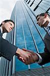 Low angle view of two businessmen shaking hands    Stock Photo - Premium Rights-Managed, Artist: Glowimages, Code: 837-02378876