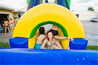 Teenage girls in an inflatable water slide    Stock Photo - Premium Rights-Managednull, Code: 837-02379105