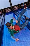 High angle view of a young man sliding in a bowling alley    Stock Photo - Premium Rights-Managed, Artist: Glowimages, Code: 837-02379262