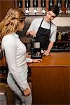 Owner showing a coffee maker to a customer    Stock Photo - Premium Rights-Managed, Artist: Glowimages, Code: 837-02379997