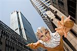 Low angle view of a young man imitating to be a tiger, New York City, New York State, USA    Stock Photo - Premium Rights-Managed, Artist: Glowimages, Code: 837-02380203