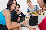 Four friends celebrating with wine and cocktail    Stock Photo - Premium Rights-Managed, Artist: Glowimages, Code: 837-02380948