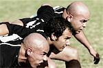 Rugby players forming scrum in a field    Stock Photo - Premium Rights-Managed, Artist: Glowimages, Code: 837-02381899