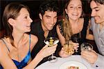 Two young couples sitting at a table and enjoying cocktail    Stock Photo - Premium Rights-Managed, Artist: Glowimages, Code: 837-02382284