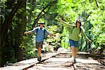 Couple Balancing on Railroad Tracks in Forest, Santa Cruz, California, USA    Stock Photo - Premium Rights-Managed, Artist: Ty Milford, Code: 700-02386009