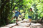 Couple Balancing on Railroad Tracks in Forest, Santa Cruz, California, USA    Stock Photo - Premium Rights-Managed, Artist: Ty Milford, Code: 700-02386010