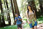 Couple Walking on Path in Forest, Santa Cruz, California, USA