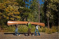 Three Women Carrying Canoe in the Forest Stock Photo - Premium Royalty-Freenull, Code: 600-02386118