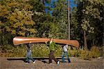 Three Women Carrying Canoe in the Forest Stock Photo - Premium Royalty-Free, Artist: Ty Milford, Code: 600-02386118