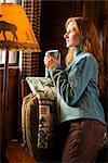 Woman With a Cup of Cocoa Looking Out Window of Cabin    Stock Photo - Premium Royalty-Free, Artist: Ty Milford, Code: 600-02386173