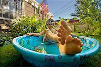 Boy wearing snorkel and lying in a wading pool Stock Photo - Premium Royalty-Freenull, Code: 673-02386686